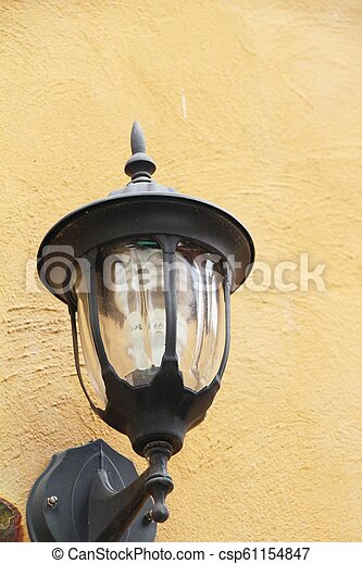 Lamp beside the brick wall vintage style - csp61154847