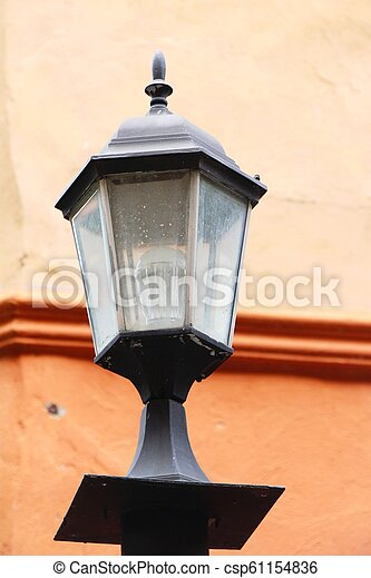Lamp beside the brick wall vintage style - csp61154836