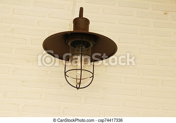 Lamp beside the brick wall vintage style - csp74417336
