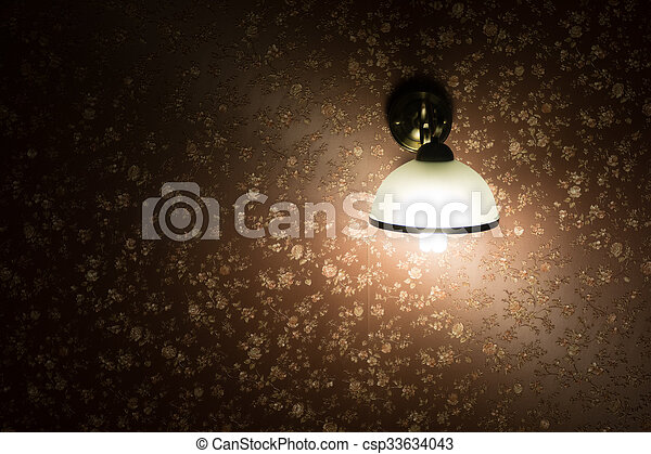 Lamp on a wall shining - csp33634043
