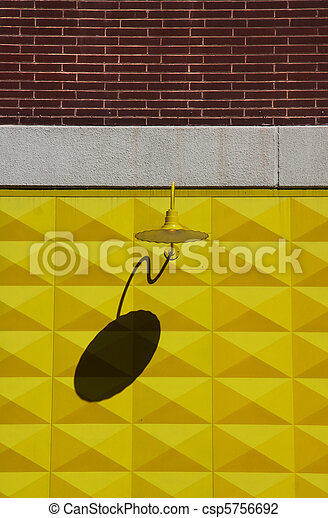 Lamp on a yellow wall - csp5756692