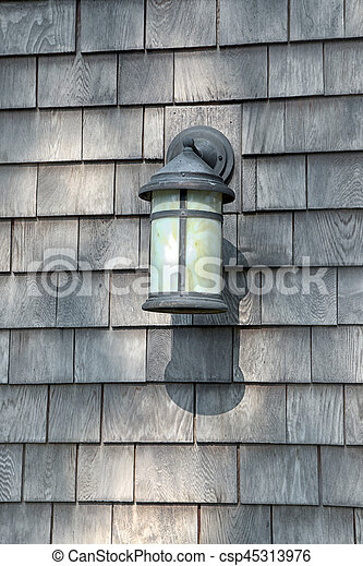 Lamp on the rustic wooden wall - csp45313976