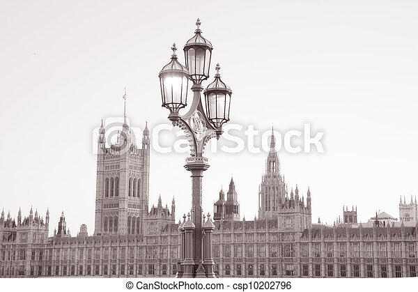 Lamppost and the Houses of Parliament; London, UK in Black and White Sepia Tone - csp10202796