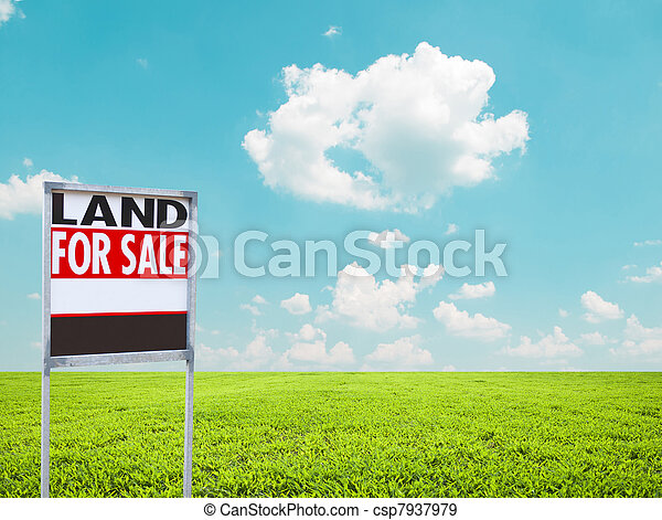 Land for sale sign on empty green field  - csp7937979