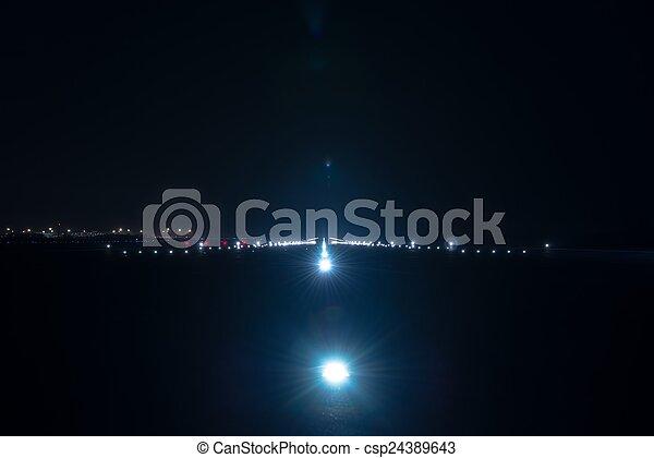 Landing lights at the airport runway - csp24389643