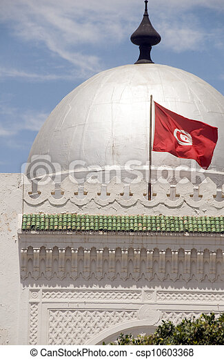 landmark large silver dome mosque Sousse Tunisia Africa with national flag flying - csp10603368