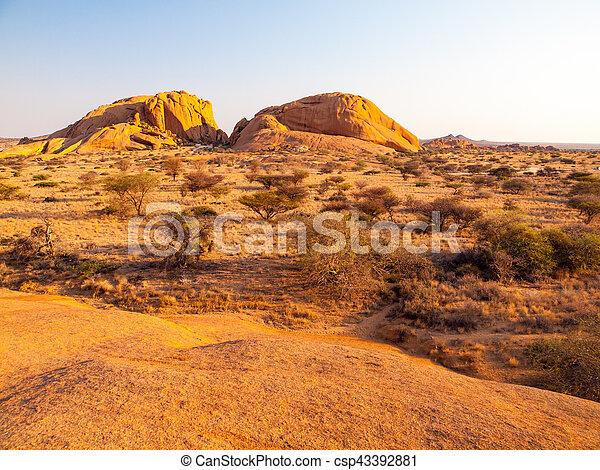 Landscape around Spitzkoppe, aka Spitzkop, with massive granite rock formations, Namib Desert, Namibia, Africa - csp43392881