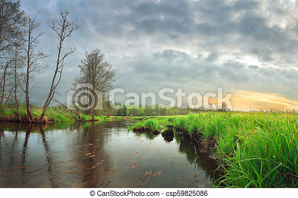 Landscape beautiful morning on the river with green grass on the shore at sunrise - csp59825086