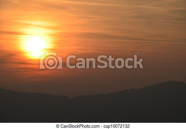 Landscape image with mountain silhouette at sunset. - csp10072132