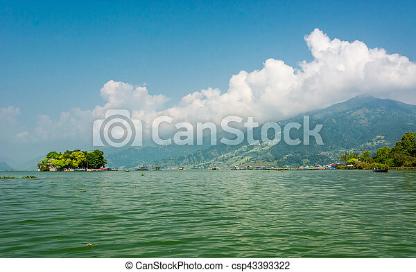 Landscape of green lake with island. - csp43393322