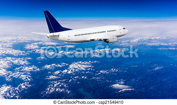 Landscape of Mountain. Airplane in the sky  - csp21549410