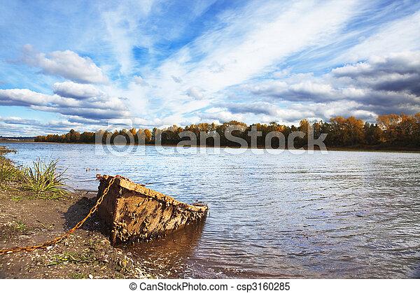 landscape of old boat on the river bank - csp3160285