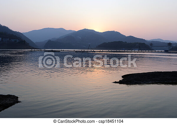 Landscape of sunset on a lake - csp18451104