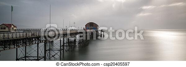 Landscape panorama long exposure peaceful image of Mumbles pier - csp20405597