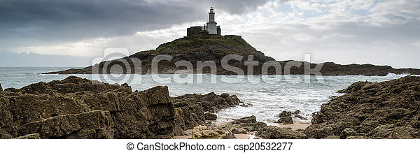 Landscape panorama of Mumbles lighthouse in Wales with sunbeams - csp20532277