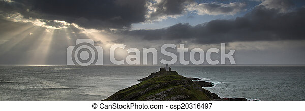 Landscape panorama of Mumbles lighthouse in Wales with sunbeams - csp20316497