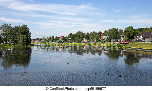 Landscape with a lake in the countryside - csp65195677
