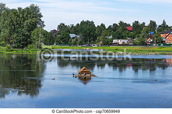 Landscape with a lake in the countryside - csp70659949