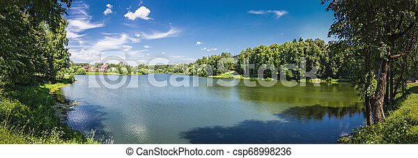 Landscape with a lake in the countryside - csp68998236