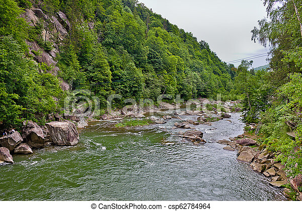 Landscape with a picturesque waterfall - csp62784964