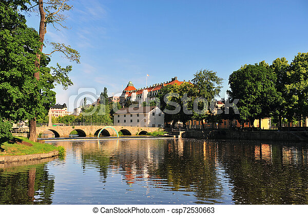 Landscape with an old bridge on river - csp72530663