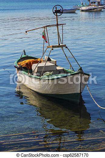 Landscape with boat in the sea - csp62587170