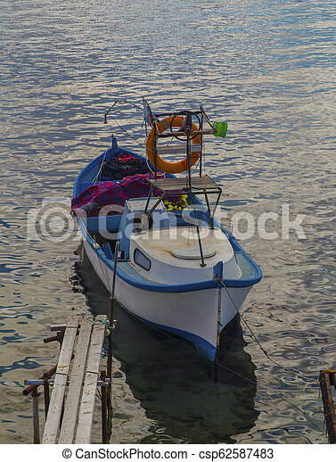 Landscape with boat in the sea - csp62587483