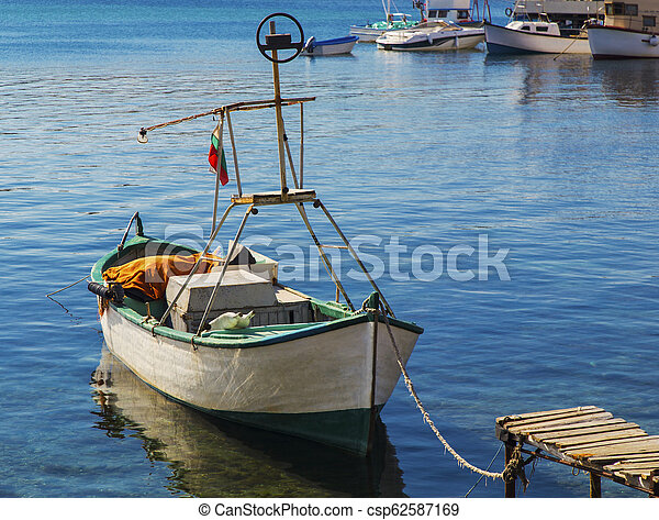 Landscape with boat in the sea - csp62587169