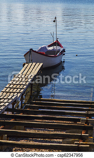 Landscape with boat in the sea - csp62347956