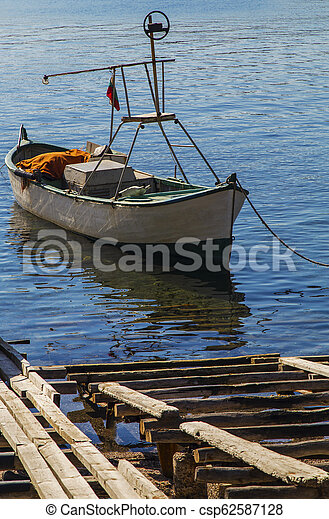 Landscape with boat in the sea - csp62587128