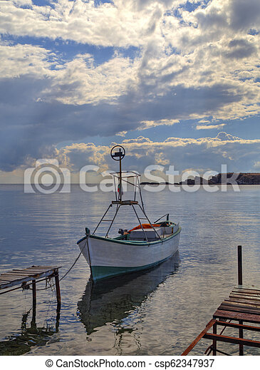 Landscape with boat in the sea - csp62347937