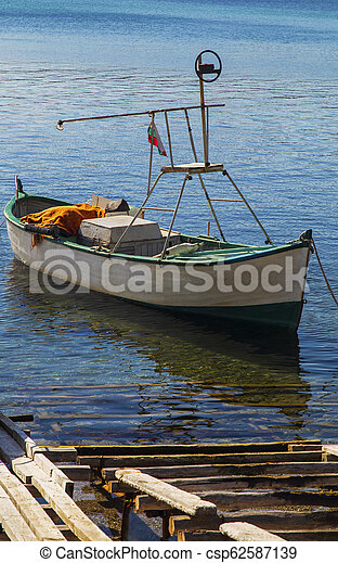 Landscape with boat in the sea - csp62587139
