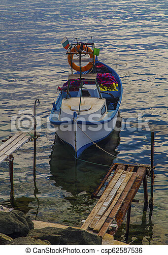 Landscape with boat in the sea - csp62587536