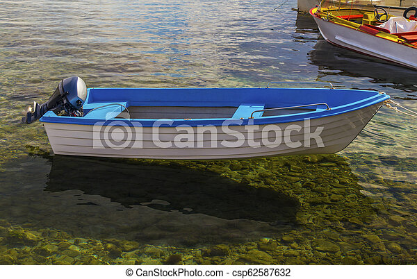 Landscape with boat in the sea - csp62587632