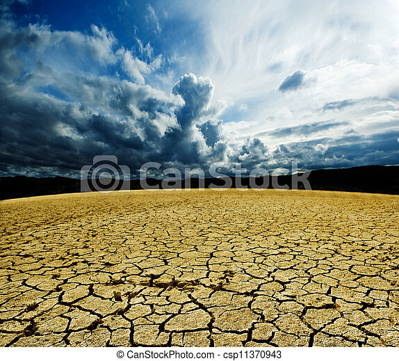 Landscape with storm clouds and dry soil  - csp11370943