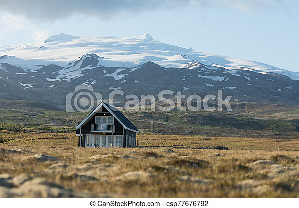 Landscape with typical house in Iceland. - csp77676792
