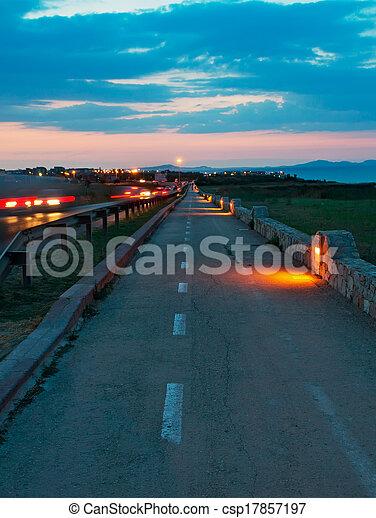 lane at sunset - csp17857197