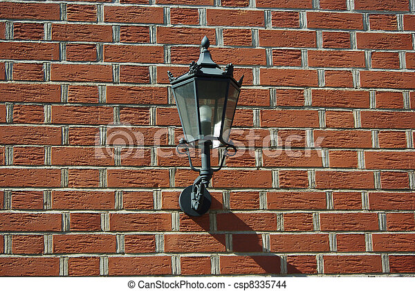 Lantern Attached To A Brick Wall - csp8335744