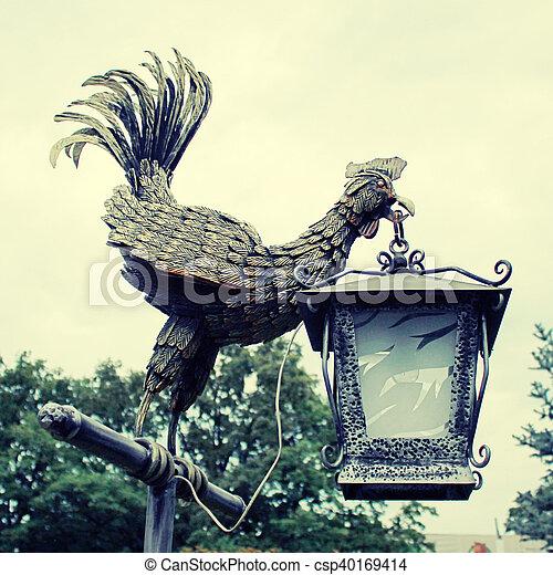 Lantern bronze cock statue in the park. - csp40169414