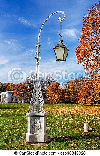 lantern in autumn park - csp30843328