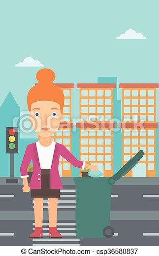 Mujer tirando basura. - csp36580837