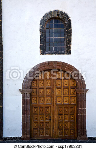 lanzarote  spain canarias brass brown knocker in a   closed wood  church door and white wall abstract   - csp17983281