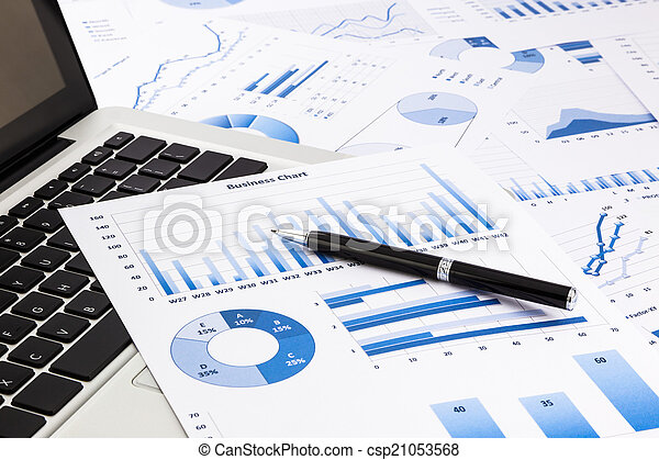 laptop and pen with blue business charts, graphs, statistic and - csp21053568