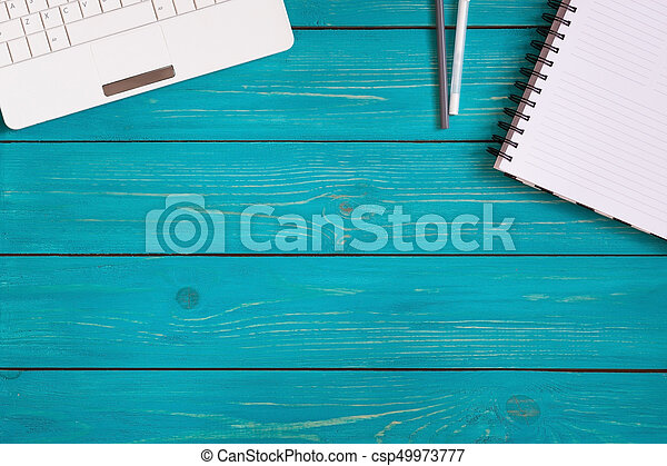 Laptop Notebook And Pencils On Wooden Turquoise Background With Space For Your Text Top