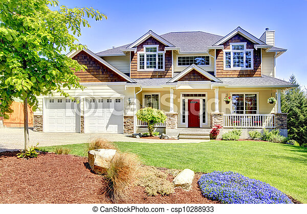 Large American beautiful house with red door. - csp10288933