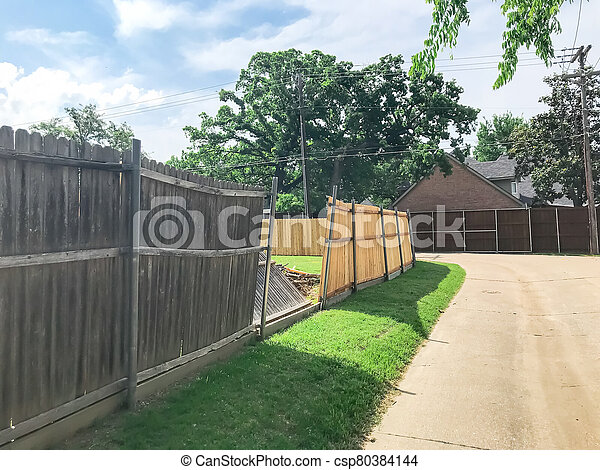 Large backyard of corner house with wooden fence replacement in progress suburbs Dallas, Texas, USA - csp80384144