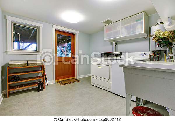 Large blue laundry room interior with sink. - csp9002712