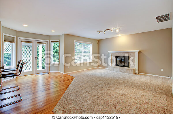 Large bright empty new living room with fireplace. - csp11325197