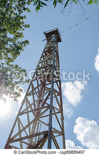 Large communication tower against the sky. - csp89889497