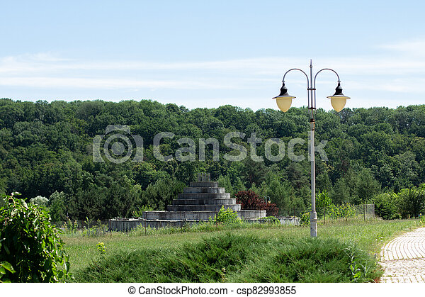 large green park with a lantern in the summer - csp82993855